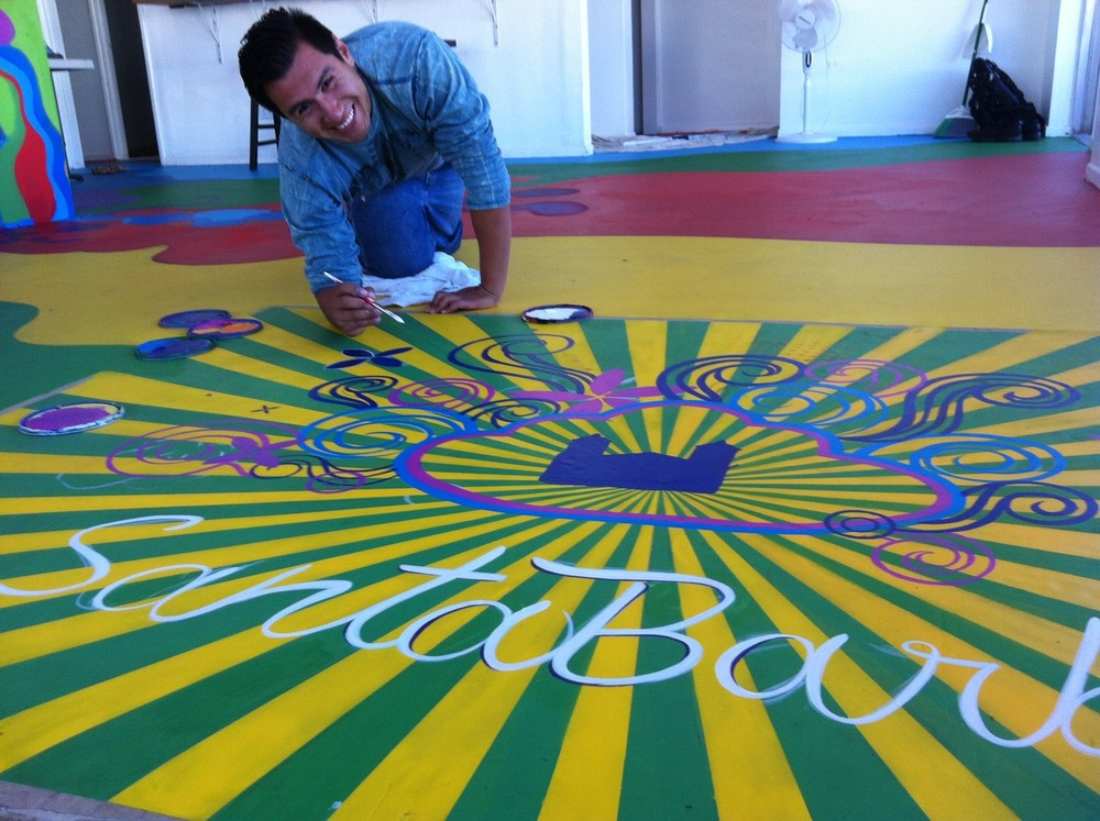 A talented artist hard at work - Jaime is finishing up his gift to Youth Interactive !!   Wow — what an amazing entrance this artwork will create !!!