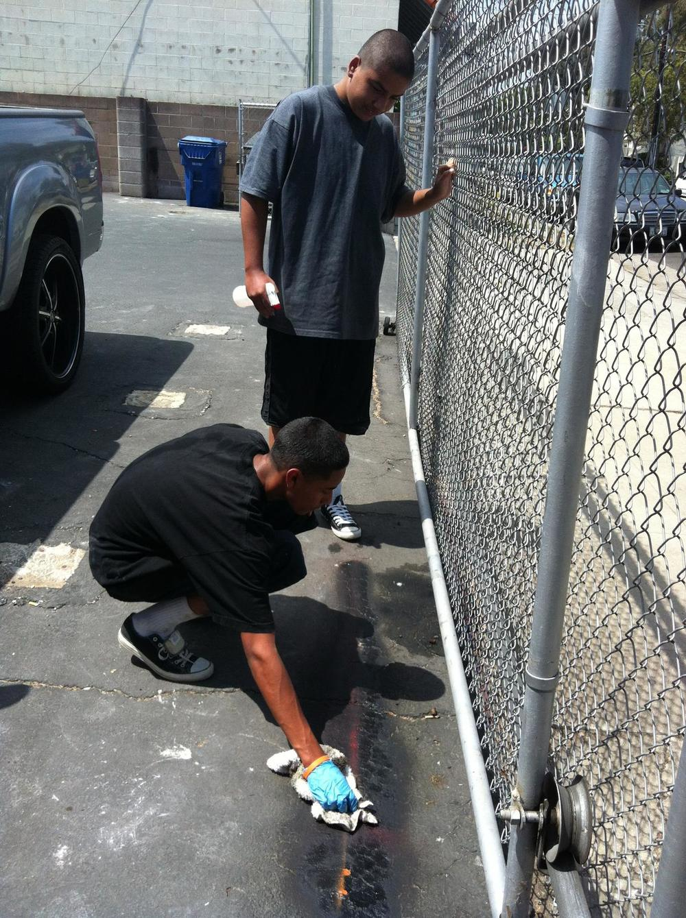 "Keeping to best practice for all… Our Artistic Students Eduardo and Nestor were responsibly cleaning up accidentally sprayed excess graffiti paint from around a canvas with a ""Looking Good Santa Barbara Cleaning Kit""  :0)"
