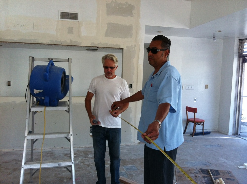 Hugh Margerum and Eduardo Mendez measuring up to see if they can donate the current stunning  Margerum Wine Counter to Youth Interactive and…. it fits - YAY !!!