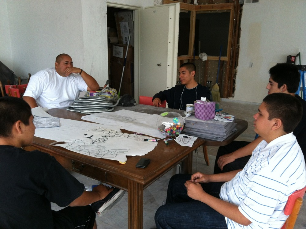 That YISB floor is going to rock!!! Graffiti Artists; Jesus, Elias, Jordy and Rafael in full design meeting!