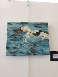 This piece is a composition of a woman floating in water. The water is painted with dull, metallic colors to represent the chemicals from pollution in our oceans. We wouldn't bathe in gasoline and car oil, so it's not fair to force marine life to do it.