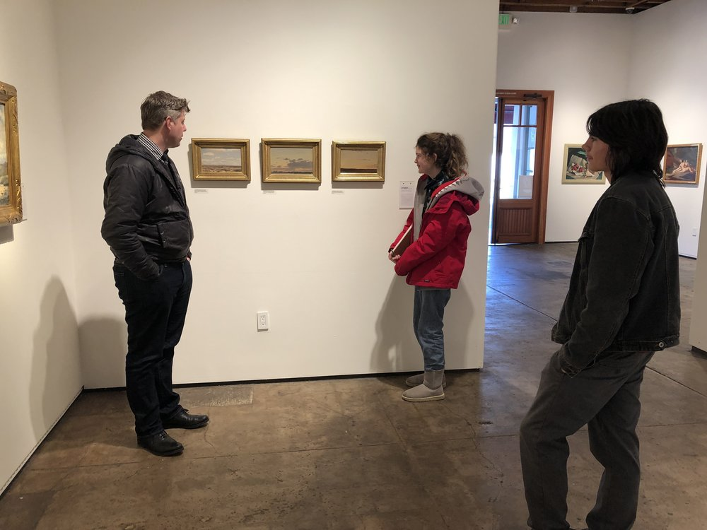 The curator, Jeremy, gives an impromptu talk about some of the art and the artists.
