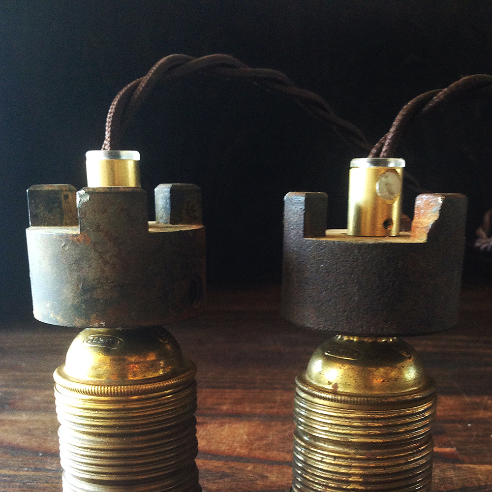 Cogs from Israel crowns the brass lamp holders.
