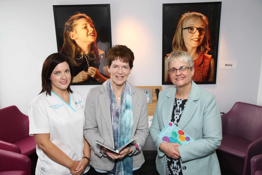 Joan White, Northern Trust speech and language therapy manager (centre) and Danelle McNulty, speech and language therapist (left) welcomed Margaret Ritchie MP to the exhibition.