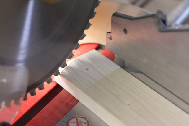 Flip the board to cut the other corner. It can help to mark both lower edges, on both front and back, with small 'x's before you start cutting.