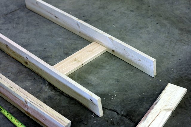 """Lay your boards out as shown, using the 13-3/4"""" 1x4 as the center brace. Line the top edge of the brace at the 12"""" mark (do not do what I have shown here, with the bottom edge lined up! I moved it before nailing - phew!) Screw or nail."""