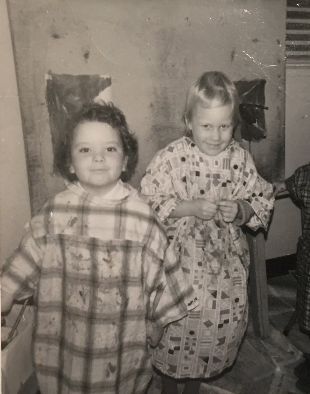 Photo of Klann (right) with her first painting (L) age three, Parkwood Terrace Preschool, New Westminster, BC.