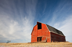 stock-photo-45160240-old-red-barn-on-the-prairie.jpg