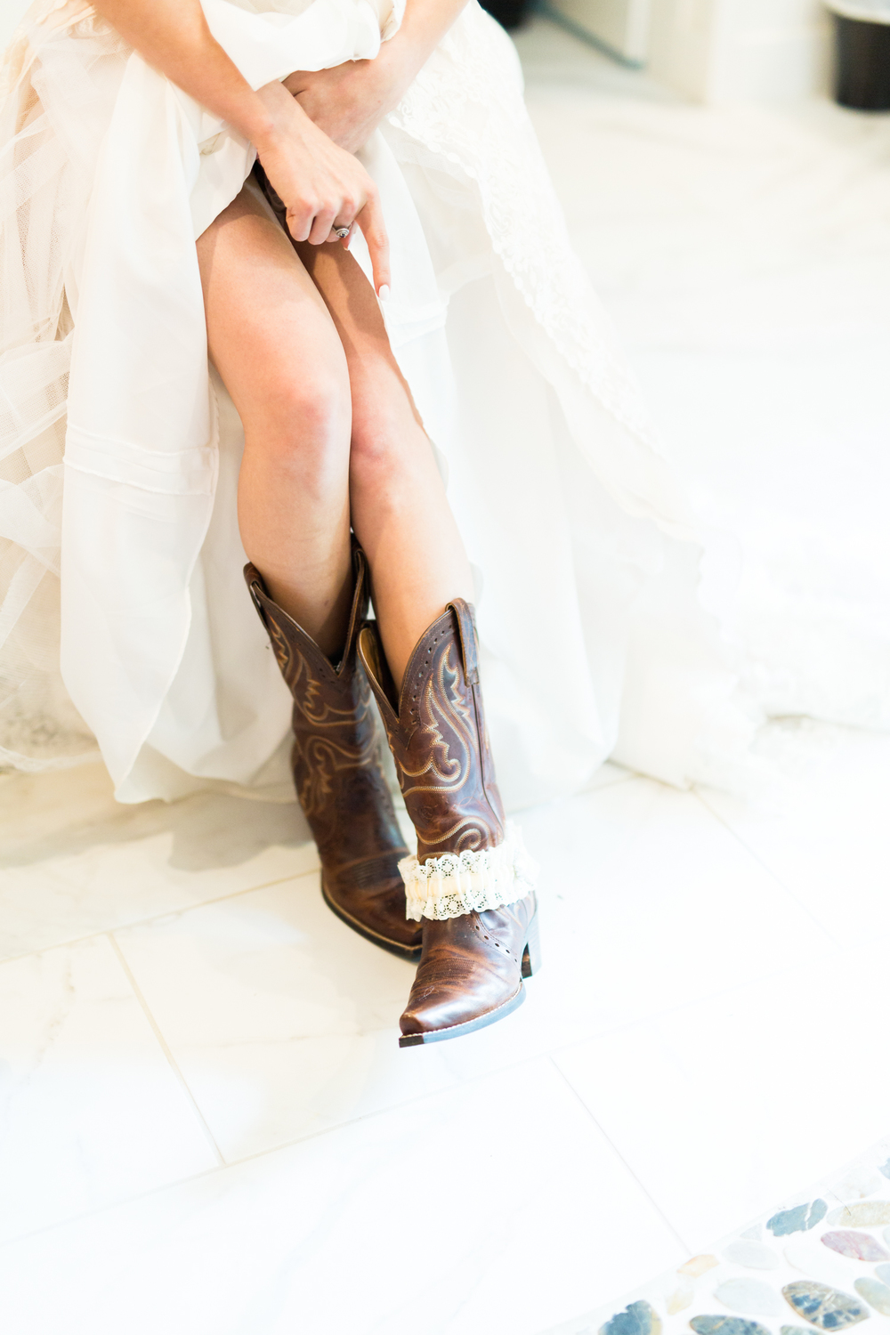 oklahoma wedding photographer pasture at willows ranch getting ready gown broken bow wedding photographer cowboy boots