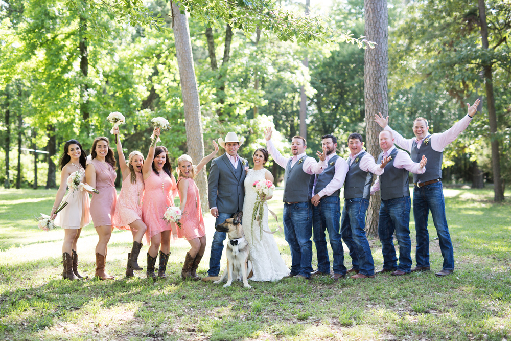oklahoma wedding photographer pasture at willows ranch broken bow bride and groom and wedding party laughing excited
