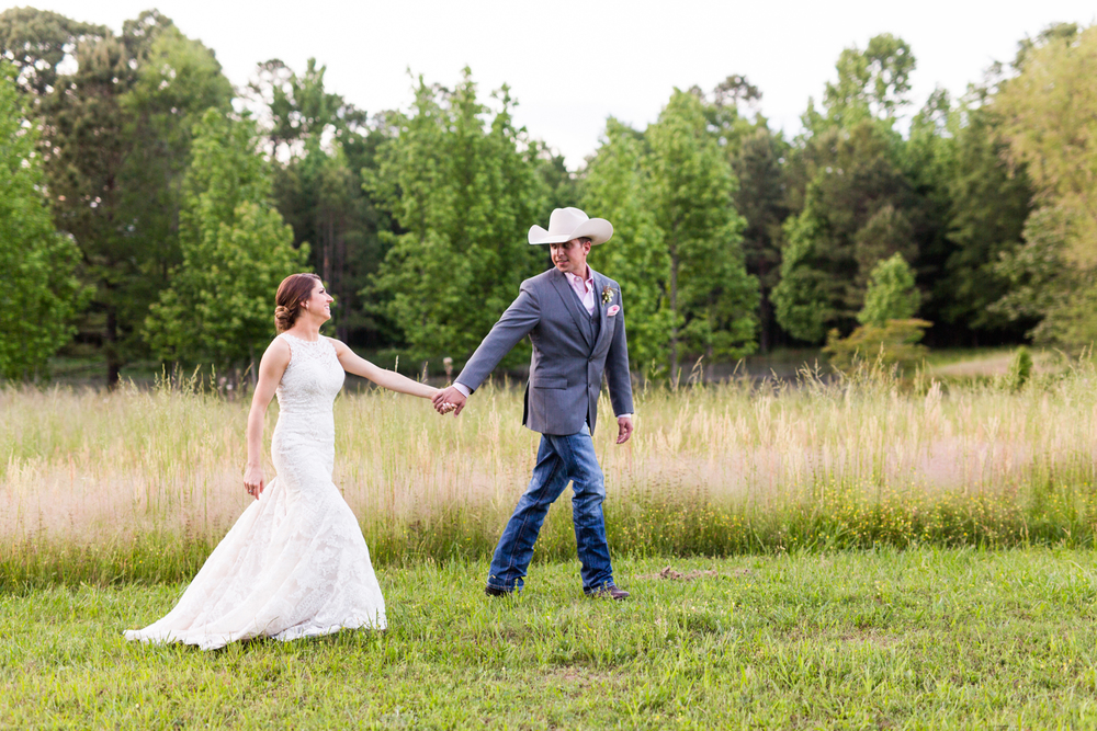 oklahoma wedding photographer pasture at willows ranch broken bow sunset wildflowers field portraits walking