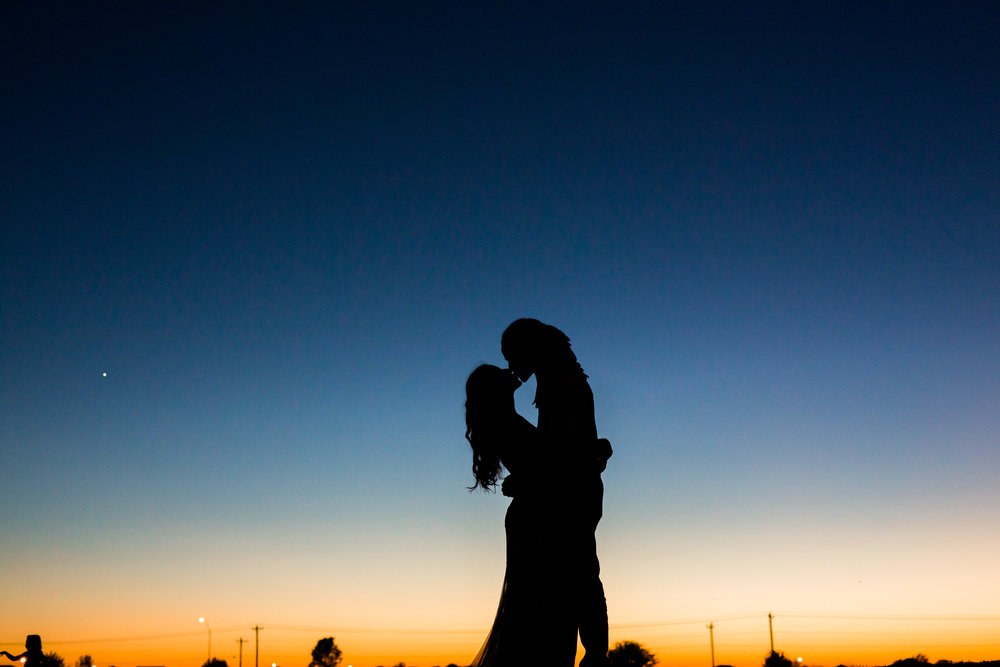 norman backyard wedding okc wedding photographer oklahoma sunset shilouette kiss