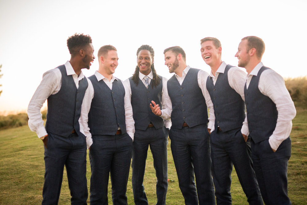 norman backyard wedding okc wedding photographer oklahoma groomsmen laughing