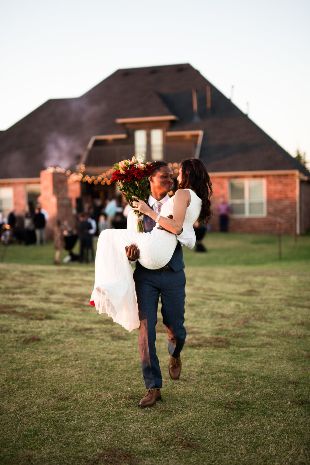 norman backyard wedding okc wedding photographer oklahoma groom carrying bride