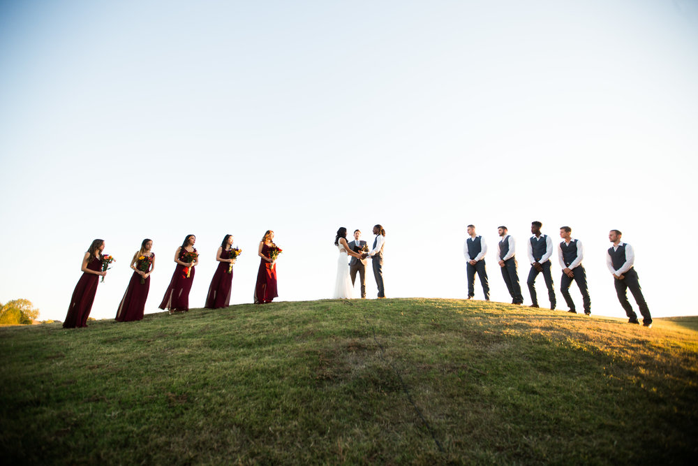 norman backyard wedding okc wedding photographer oklahoma ceremony on a hill wide shot