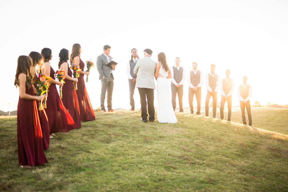 norman backyard wedding okc wedding photographer oklahoma ceremony on a hill at sunset