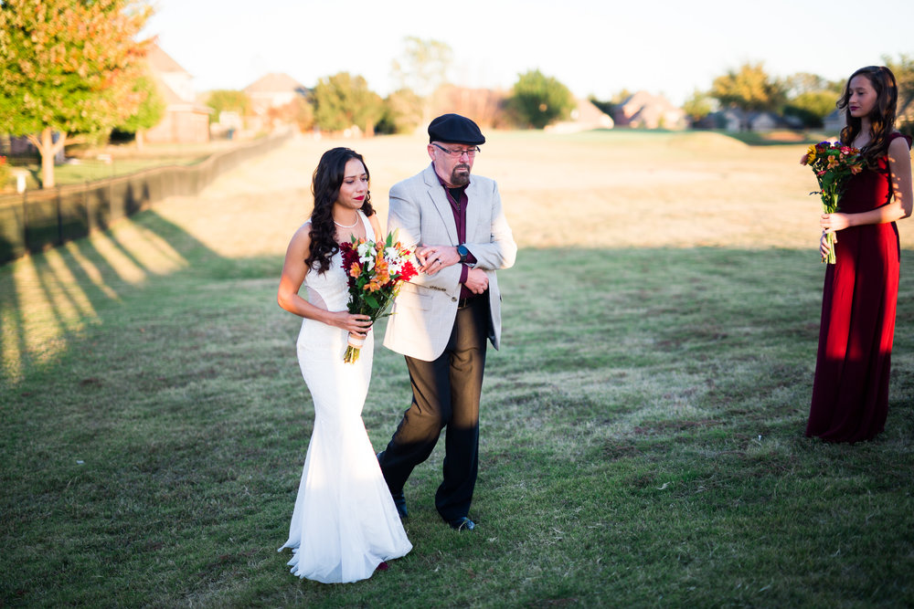 norman backyard wedding okc wedding photographer oklahoma bride walking down aisle