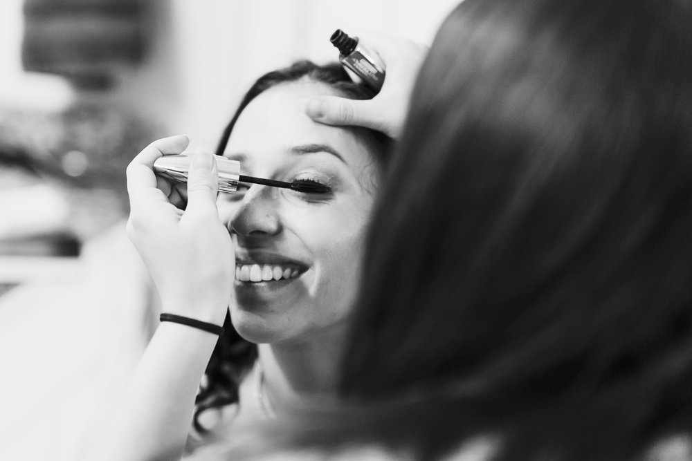 norman backyard wedding okc wedding photographer oklahoma getting ready mascara laughing