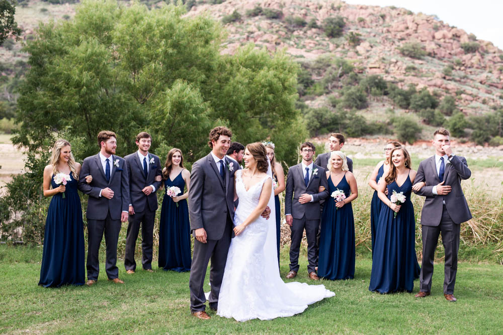 quartz mountain wedding oklahoma wedding photographer smiling bride norman lake beach mountains beach pretty woods bridal party