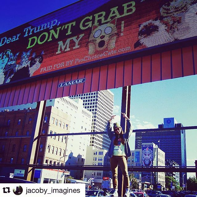 "INSTAGRAM PRODUCT GIVEAWAY... How to enter: 1. Follow @prochoicecats on Instagram 2. Take a pic of yourself underneath our anti-Trump billboard on the corner of 3rd and Spring Street in Downtown Columbus, Ohio 3. Post to Instagram with the hashtag #LeaveMyPussyAlone. Make sure to tag @prochoicecats in the photo.  The winner will be randomly selected on Oct 31, 2016. One lucky human will win the following items: • Boob ring (a ring for your finger that just happens to have a fake boob mounted on the top) • Pro Choice Pussy buttons and stickers • Bumper sticker (""Dump the Trump Into Your Litter Box"") • Your choice of t-shirt or tank top  Photo credit: @jacoby_imagines on IG"