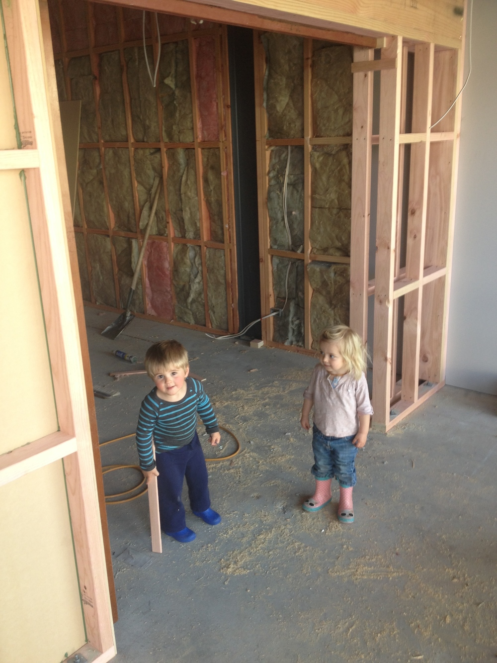 Indigo and cousin Jed help tidy the building site