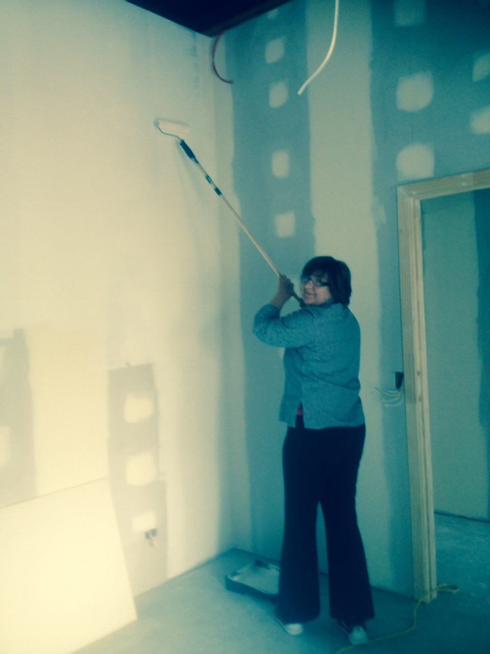 Judy adding the first undercoat to our walls