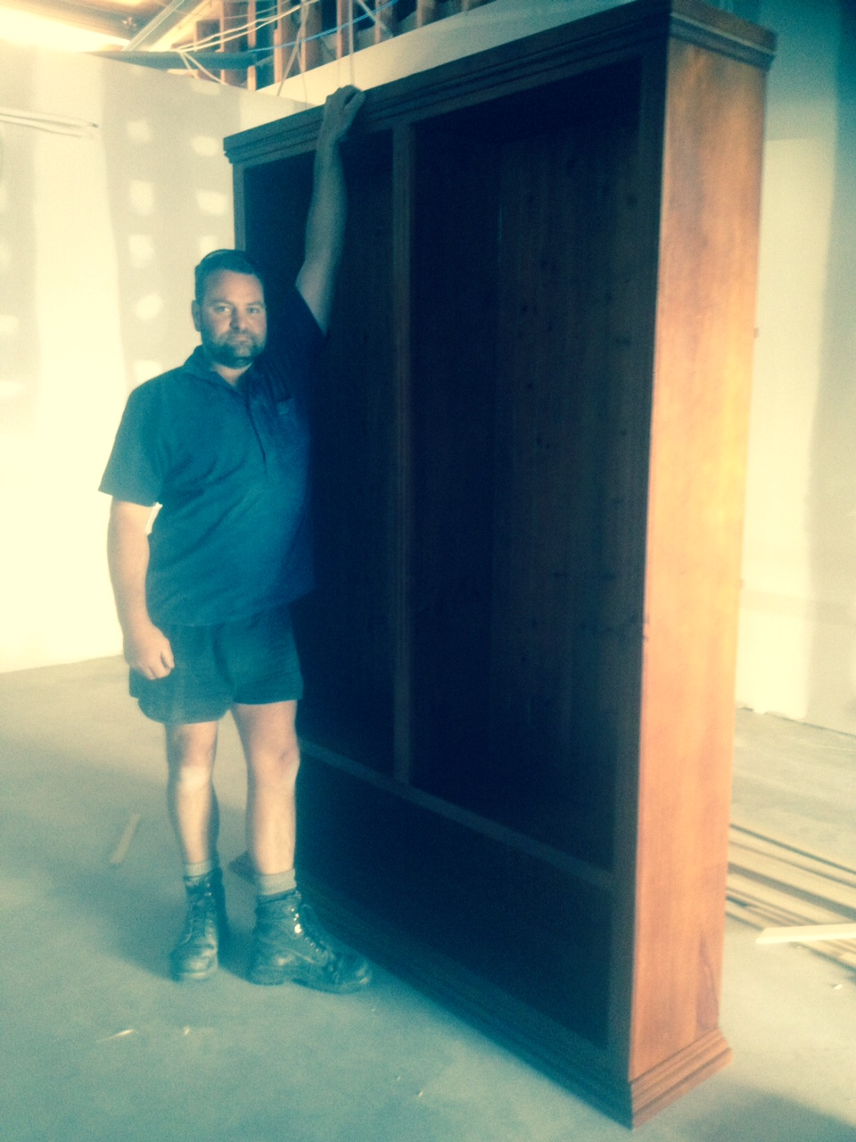 Dan our 'cover boy' (!) modeling the therapists' bookcase, pre- the sanding and antiquing-process