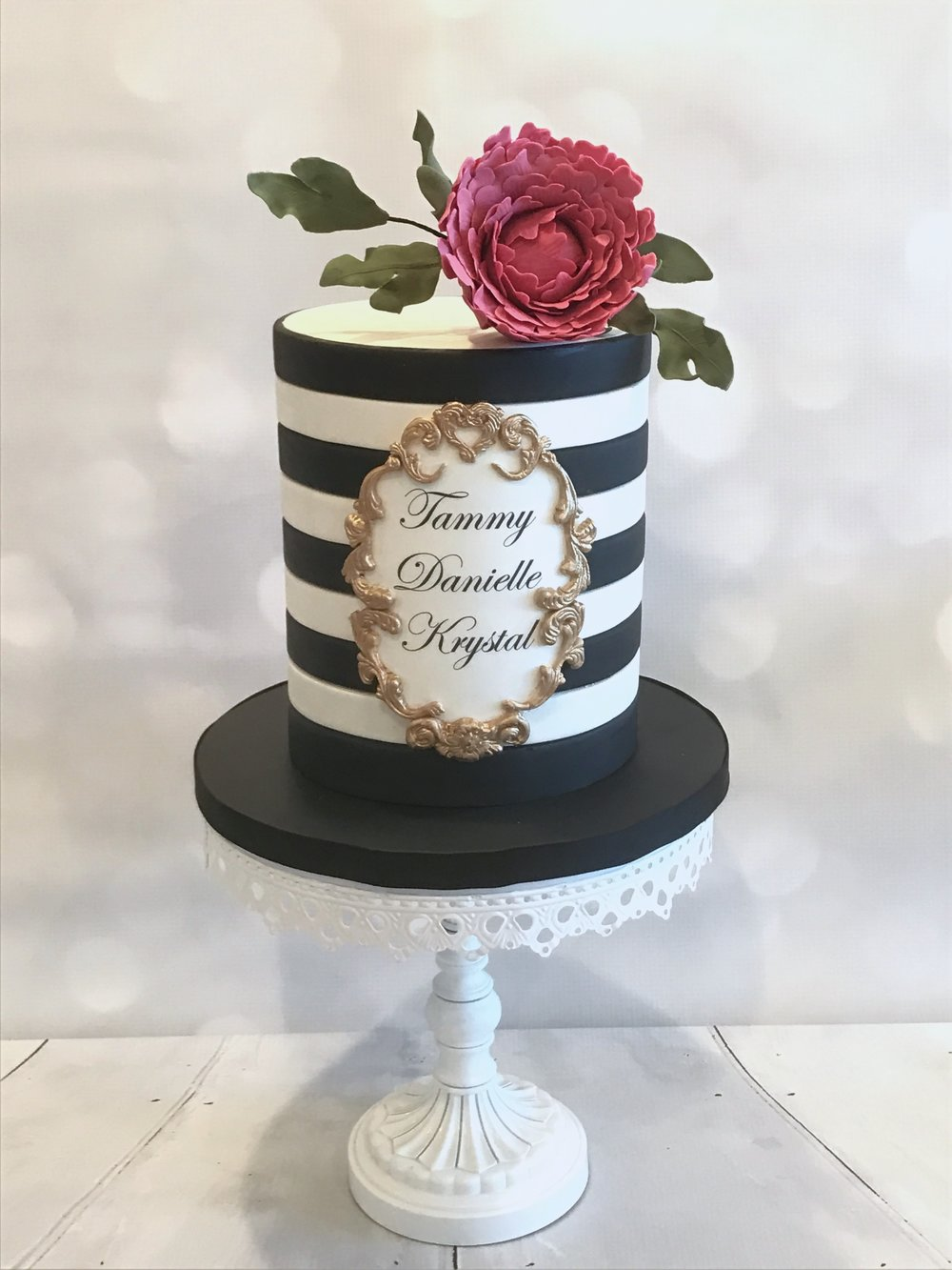 """Black & White Striped Cake with """"Ormolu"""" Plaque, topped with a Peony"""