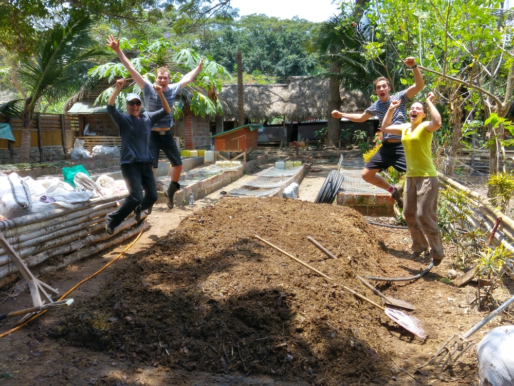 Volunteers Julie, Nick, Henri, and Celine Celebrate the Success of Rio Muchacho's First Composting Shower.