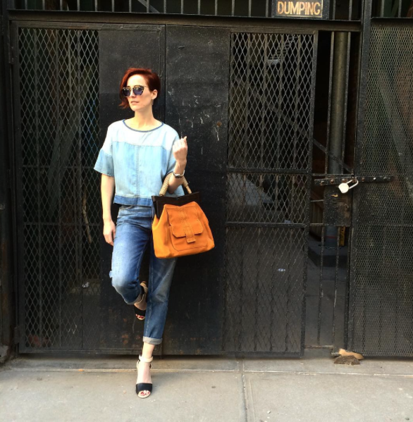 Hillary wears MIH Jeans coupled with Miu Miu sunglasses, a DVF handbag and Chloe heels.