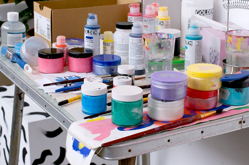 Mixing and testing paint colours. Photo by Susan Fitzgerald.