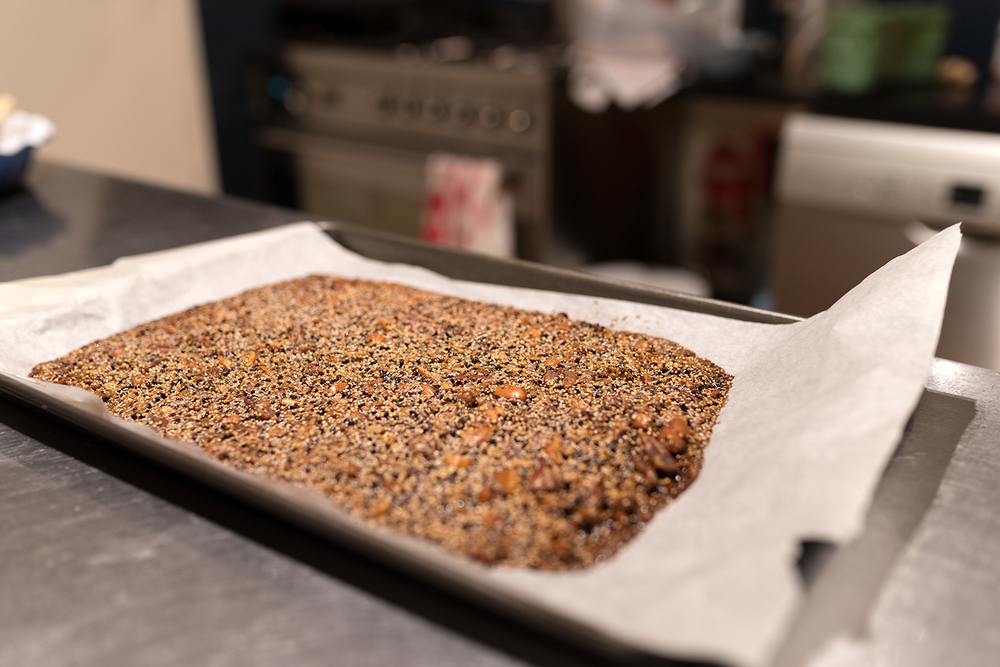 Lunch Lady's quinoa brittle, just out of the oven. I'm looking forward to trying some other recipes next - this quinoa crunch, these quinoa snack bars and peanut butter quinoa crunch. Photo by Susan Fitzgerald.