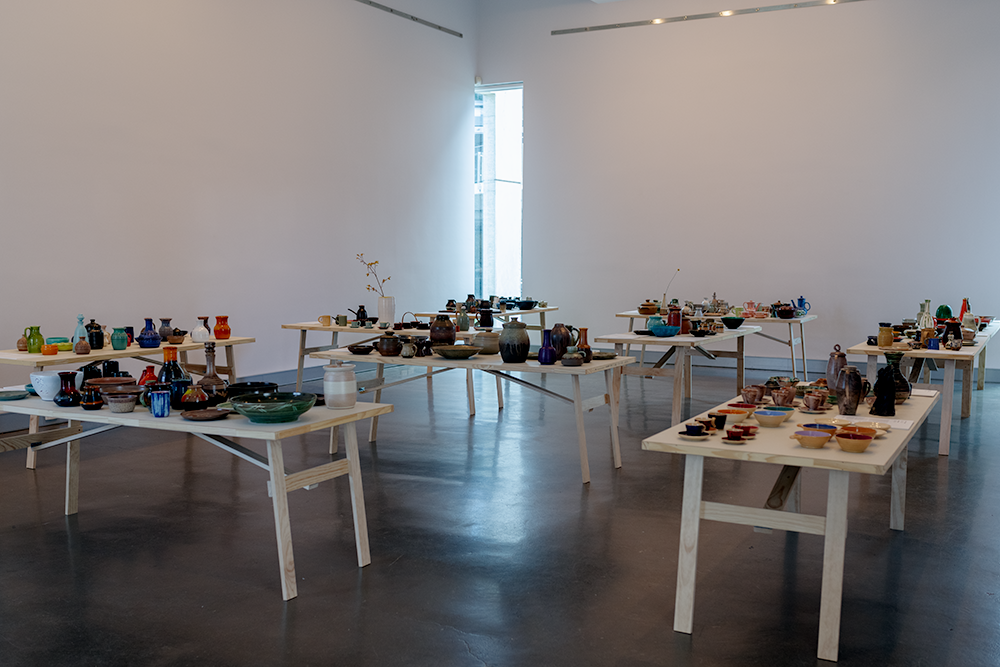 The various trestle tables, arranged around the gallery