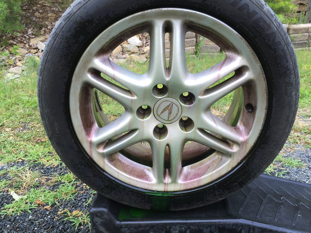 "Wheels off decontamination with brake dust activated wheel cleaner. The wheel appears to be ""bleeding"" brake dust, as the specially formulated wheel cleaner dissolves the brake dust, it turns a reddish color."