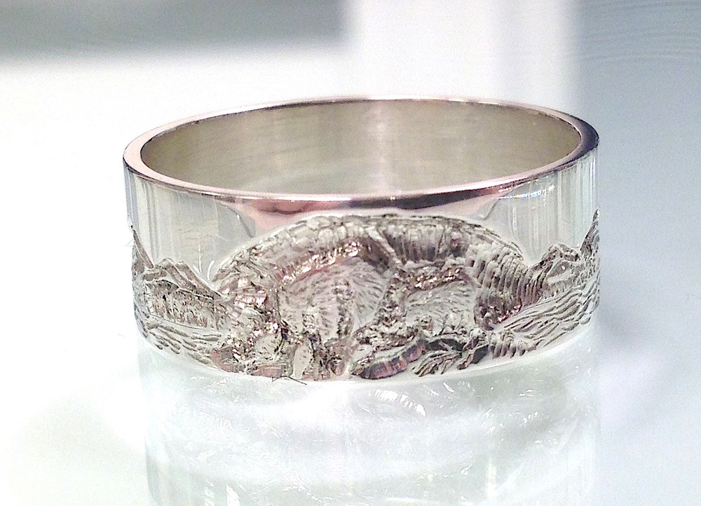 siver ring with grizzly mom and cup.JPG
