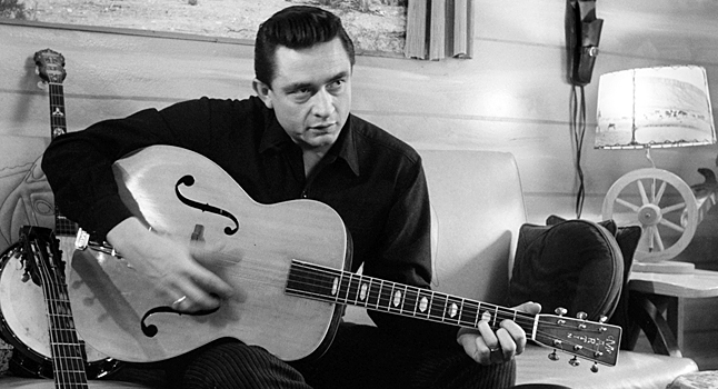 Johnny, strumming a 'D' chord on his archtop Martin guitar. This one doesn't say 'Johnny Cash' on the fret board, which is a little disappointing.