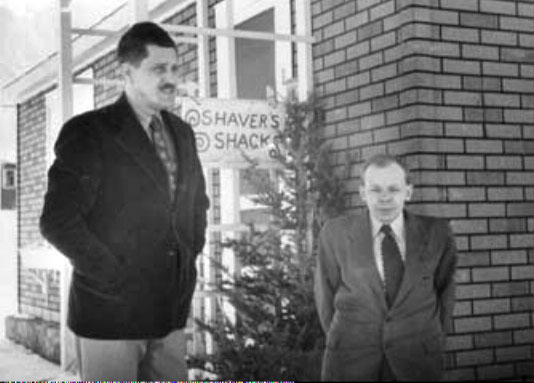 Richard Shaver and Ray Palmer, outside the studio that Shaver did his writing from. No, Palmer is not kneeling.