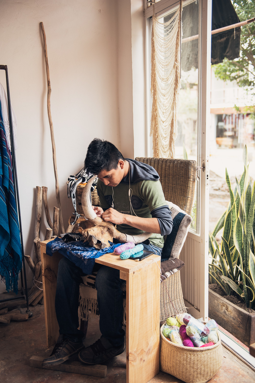 Hand weaving onto a skull at Evoke the Spirit // Sayulita, Mexico // Ashley Petersen Photo