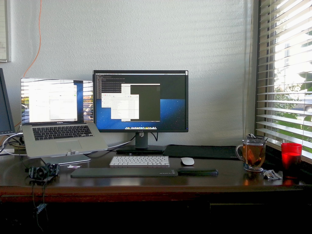 My first computer setup as a full time software developer. 2010 15 inch Macbook Pro, 23 inch dell monitor, magic mouse, wrist pads.