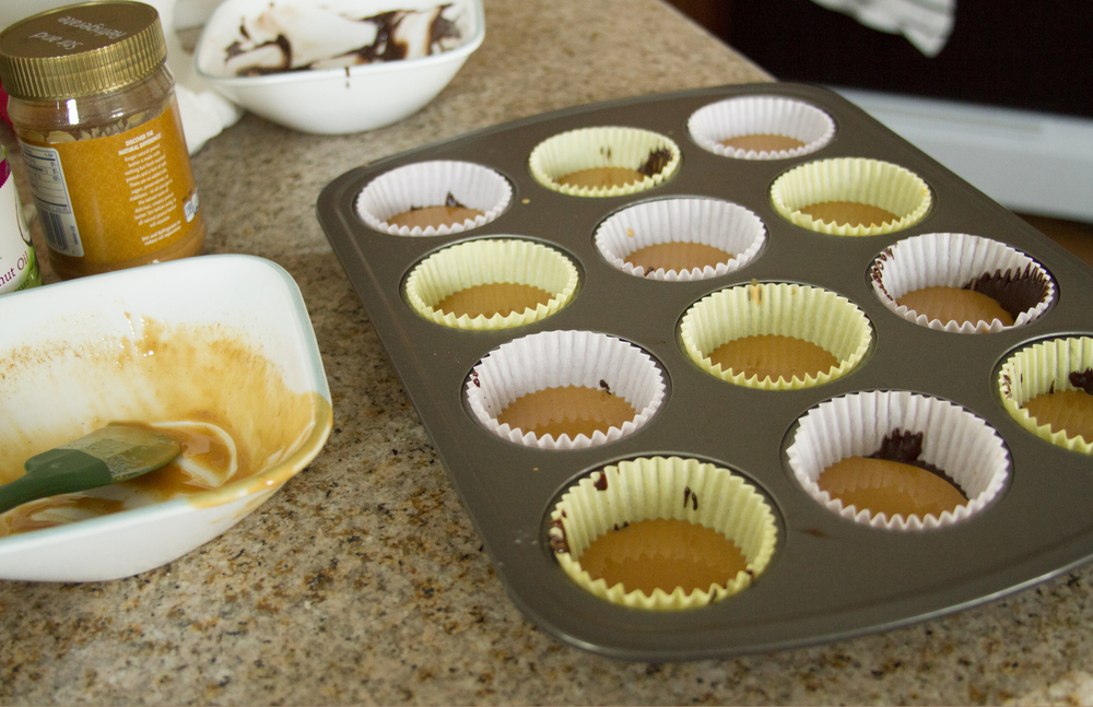 With the new layer on top of the chocolate, put the muffin tray back into the freezer for an additional 10-15 minutes.