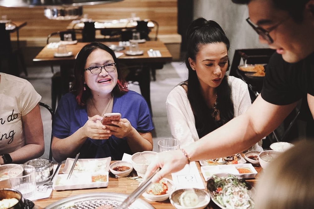 Me gawking at the food while Jen is ready to see what our server will give us next! // Photo by  Tyler Rae Mills
