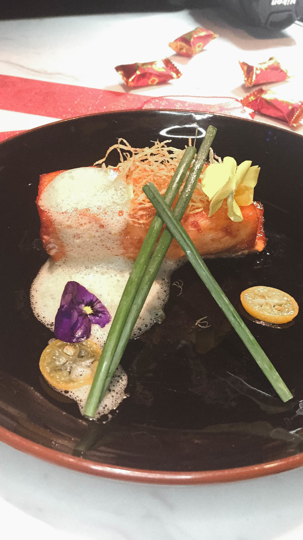 Baked Chilean sea bass with Kumquat glaze