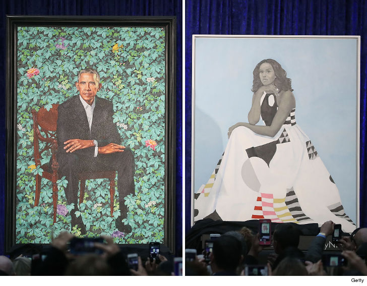 Kehinde Wiley's portrait of Barack Obama alongside Amy Sherald's portrait of Michelle Obama  after their unveiling at the the National Portrait Gallery in Washington, D.C. on February 12, 2018.