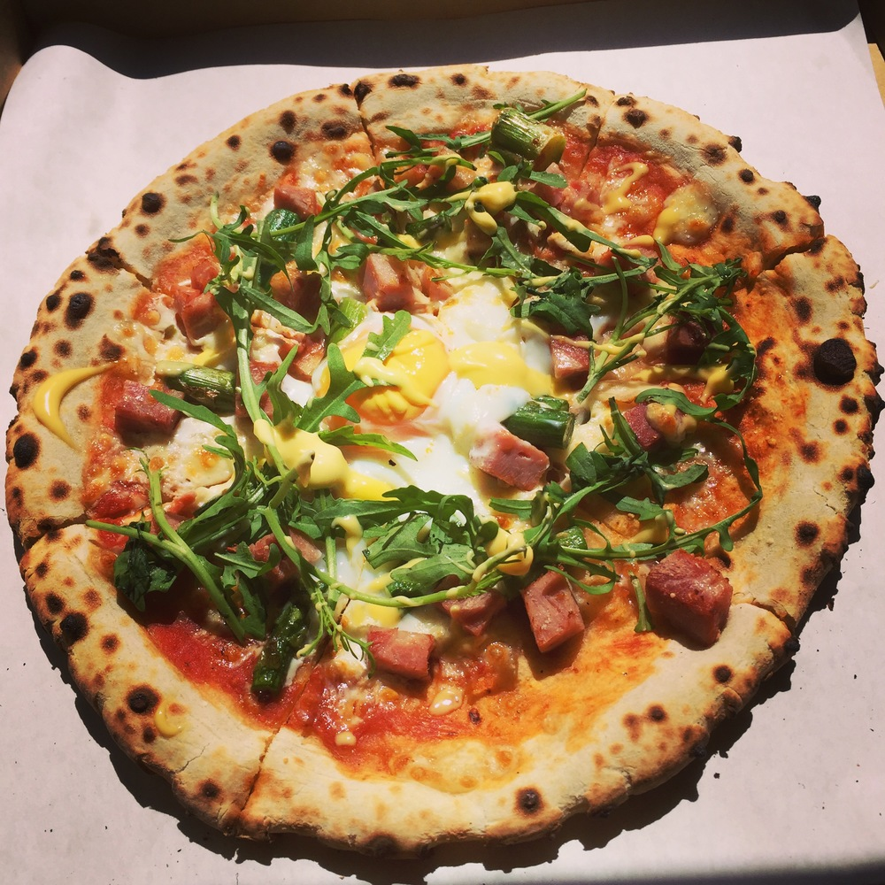 Wood Fired Sourdough Pizza - English Ham, Asparagus & Egg finished with fresh Rocket & Hollandaise Sauce
