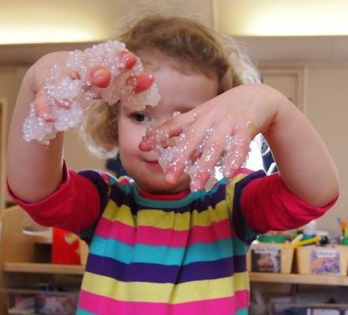 Playing with home-made messy play frog spawn