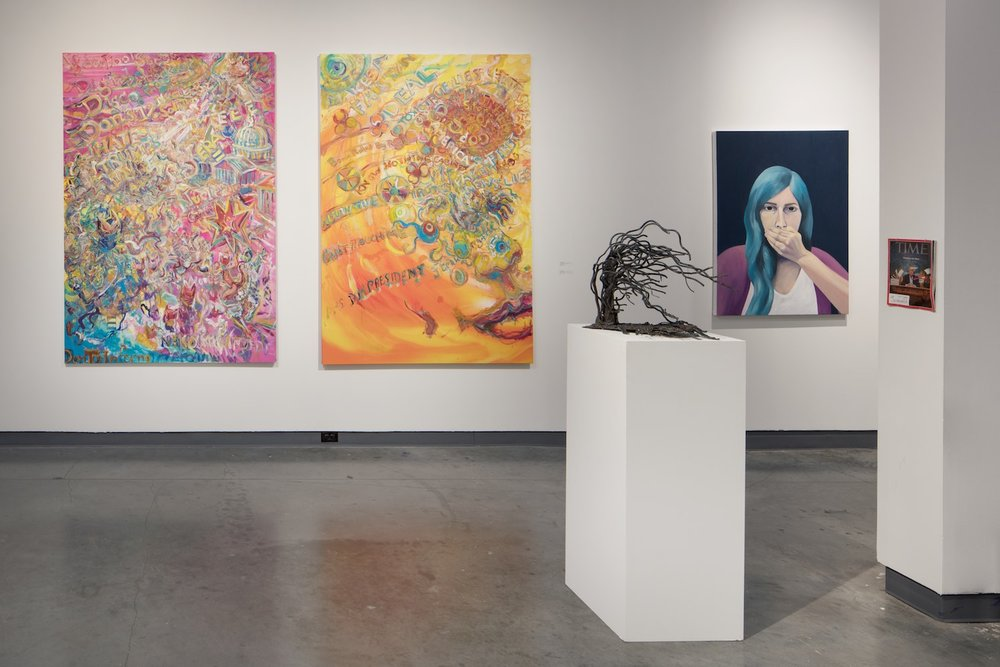 From the State of the Union side, from left to right, two large canvases by Ken Mabrey, a sculpture by Anne Oldach and a painting by Lauren Peters
