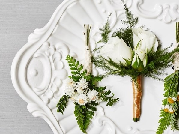For the groom/groomsmen, a stylish and classic combination of white and green is sure to make a statement. Styling by Megan Wappel Designs.  Flowers by Stôk Floral & Design.  Photo by Carlo Mendoza.