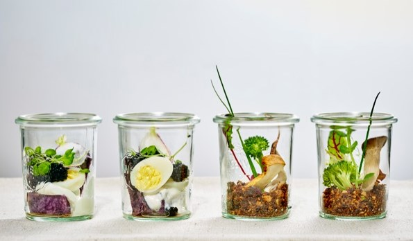 Transparent jars are the way to go to make appetizers look absolutely irresistible.  Consult your caterer and get creative with display options like these whimsical terrarium-like jars of edible art.  Styling by Megan Wappel Designs.  Appetizers by O&B Caters.  Photo by Carlo Mendoza.