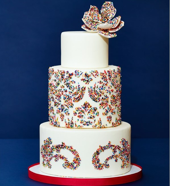 For a fun and sophisticated twist on wedding cake, try sprinkles!  For this unique confection, The Wedding Cake Shoppe used whimsical funfetti on a classic damask and flower motif.  Styling by Megan Wappel Designs.  Cake by The Wedding Cake Shoppe.  Photo by Carlo Mendoza.