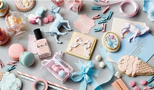 Rose Quartz and Serenity aka Pantone's colours of the year are the perfect combination of fun and elegance to create the most perfectly dreamy and romantic wedding day design.  Styling and stationery by Megan Wappel Designs.  Ribbon, tape, rose petals and mini clothing pins from Creative Bag.  Nail polish from Lauren B. Beauty.  Painted cookies and macarons by Nadia & Co.  Candy from Sugarfina.  Ribbon cookie by Confetti Co.  Ice cream cookies by Whisk.  Photo by Carlo Mendoza.